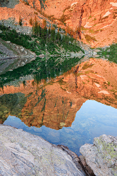 Hallet Peak Reflects in the waters of Emerald Lake in Rocky Mountain National Park