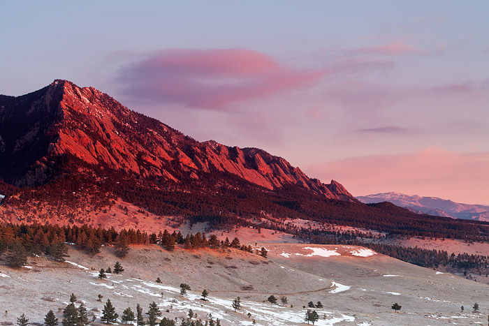 The Flatirons of Boulder, Colorado light up at Sunrise
