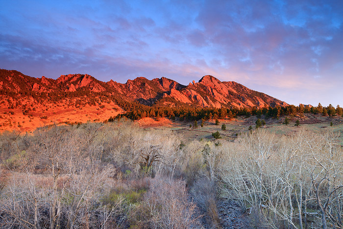 South Boulder Creek Meanders through the bottom of the frame as sunrise lights up the Flatirons and South Boulder Peak