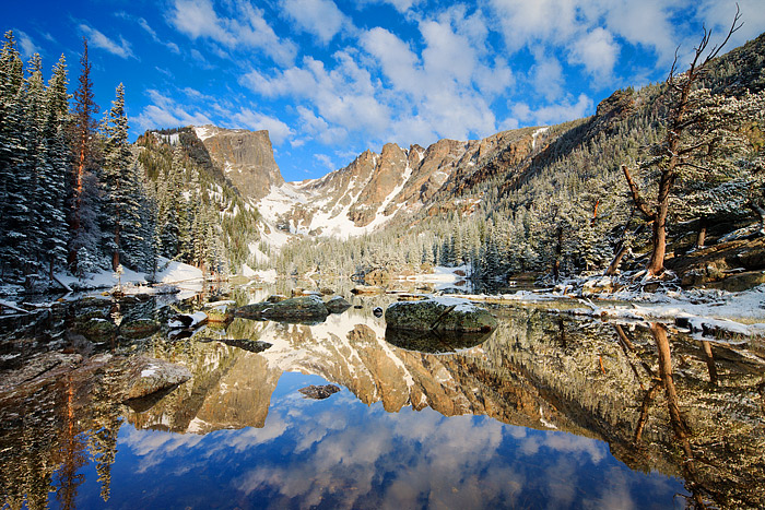 Dream Lake Sunrise, Rocky Mountain National Park. Hallet and Flattop Mountain reflect in the glassy surface of Dream Lake