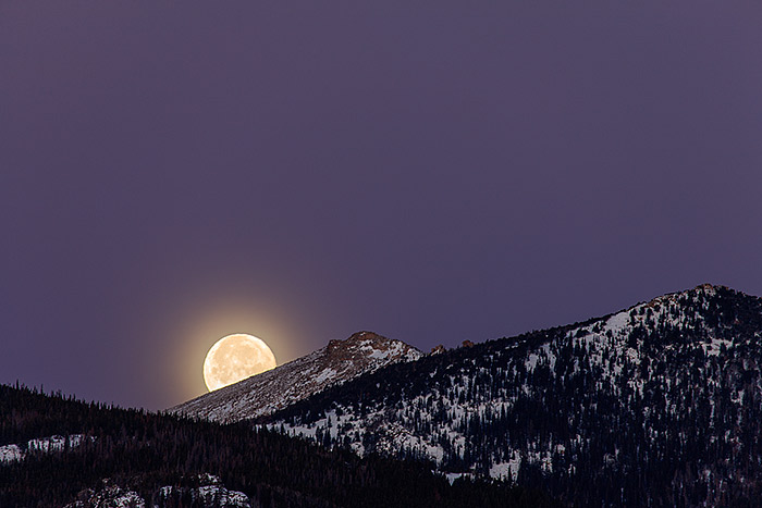 A setting full moon over Beaver Mountain, Rocky Mountain National Park, Colorado