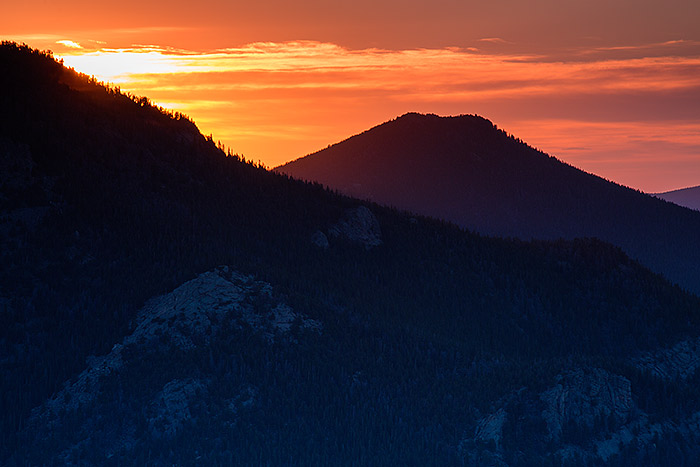 A muted sunrise illuminates the skies over Dark Mountain and Lumpy Ridge. I was able to photograph this view of Rocky from Rainbow Curve along Trail Ridge Road which is now open for the season. Technicial Details: Canon EOS 5D Mark III, 70-300mm F4-5.6 L