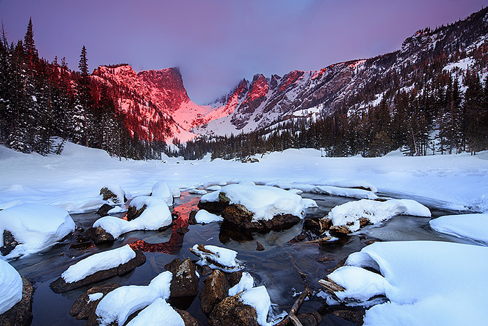 Spring sunrise on Dream Lake. It's been a long cold spring in Rocky Mountain National Park. I took this image of Dream Lake the first week of May. The outlet to Dream Lake had just begun to thaw out allowing for me to capture a slight reflection of Hallet Peak in the icy waters. Technicial Details: Canon EOS 5D Mark III, 17mm TS-E F4 L