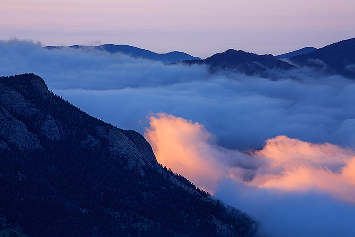 Here is a great example of conditions I encountered last week in Rocky during an inversion. Estes Park was mired in clouds, but driving Trail Ridge Road up to Rainbow Curve allowed me to get above the clouds to photograph a brief sunrise along the flanks of Deer Mountain. Technical Details: Canon EOS 5D Mark III, 70-300mm F4-5.6 L