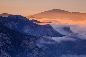 A dramatic sunrise over the granite comprising Lumpy Ridge last week. Again, the inversion helped to trap clouds along the peaks of Lumpy Ridge while the sunrise kissed the top of the fog and clouds with some warm light. Technical Details: Canon EOS 5D Mark III, 70-300mm F4-5.6 L