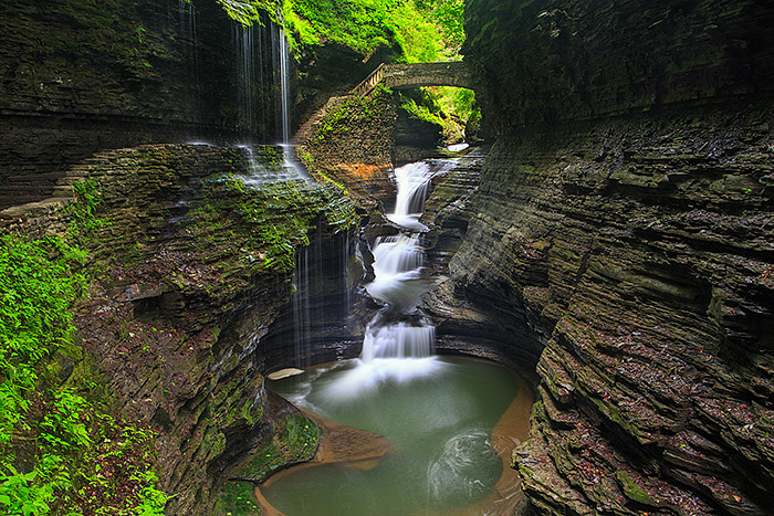 Watkins Glen is one of my personal favorite locations when photographing the Finger Lake regions of New York. Waterfalls abound in the Glen and the possibilities for photographers are endless. Rainbow Falls area is an iconic location in Watkins Glen for obvious reasons. Photographing in Watkins Glen is quite different from the normally arid locations I used to photographing out west. Technical Details: Canon EOS 5D Mark III, 24-105mm F4 IS L