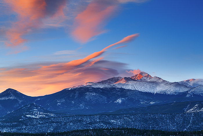 Longs Peak greets a beautiful but windy morning in Rocky Mountain National Park. Fresh snow has fallen on Rocky's highest peak and the high winds have formed beautiful lenticular clouds which glow in the early morning light. Technical Details: Canon EOS 5D Mark III, 70-300mm F4-5.6 IS L