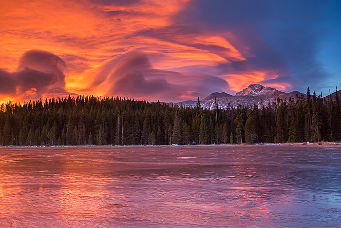 One of the most colorful and dramatic sunrises I've been lucky to experience unfolds over a frozen Bierstadt Lake. Lenticular clouds formed east of Longs Peak and the rising sun lit the underbelly of the clouds in rainbow like fashion. Technical Details: Canon EOS 5D Mark III, 24-105mm F4 IS