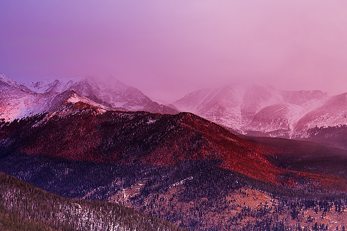 Sunrise unfolds over the Mummy Range and Ypsilon Mountain on the winter solstice. Snow squalls and clouds are seen blowing over the peaks of the Mummy Range as a colorful magenta sunrise briefly lights the mountainsides. Technical Details: Canon EOS 5D Mark III, 24-70mm F4 IS L