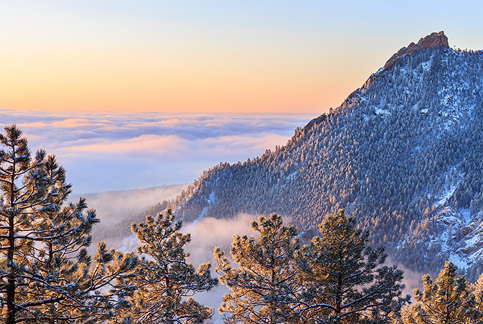 Sunrise from the summit of Flagstaff mountain was something to behold. Snow had fallen on Boulder and the Flatirons coating them in white. Low clouds from an inversion hung over the eastern plains of Colorado covering Boulder and Denver and allowing for this view of the Flatirons at sunrise. Technical Details: Canon EOS 1Ds Mark III, 24-70mm F4 IS L