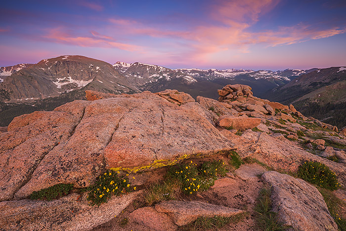 Sunrises from the top of Trail Ridge Road exemplify the Rocky Mountain National Park experience. Here the skies over Forest Canyon explode with color as wildflowers grow between the rocks and boulders found above treeline. Technical Details: Canon EOS 5D Mark III, 16-35mm F4 IS L