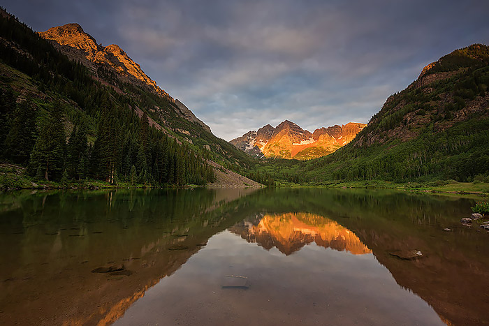 Drop under light illuminates North and South Maroon Peak from Maroon Lake. I've spent many mornings along the shores of Maroon Lake but I've never been lucky enough to be here to witness a sunrise like the one this particular morning.Technical Details: Canon EOS 5D Mark III, 16-35mm F4 IS L
