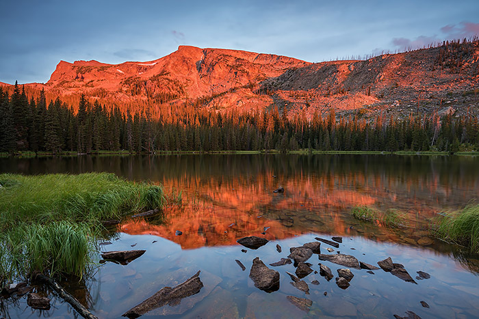This time of year one has many options when photographing in Rocky Mountain National Park. With the seasons transitioning from summer to fall one can chose to photograph summer like scenes as well as scenes more representative of autumn. Of course the trick this time of year is doing so before the weather sets in and alters ones plans. Last week I was able to photograph this summer like sunrise at Ouzel Lake in Wild Basin, while at the same time photographing some early fall color as well. Technical Details: Nikon D810, Nikkor 16-35mm F4 ED VR lens