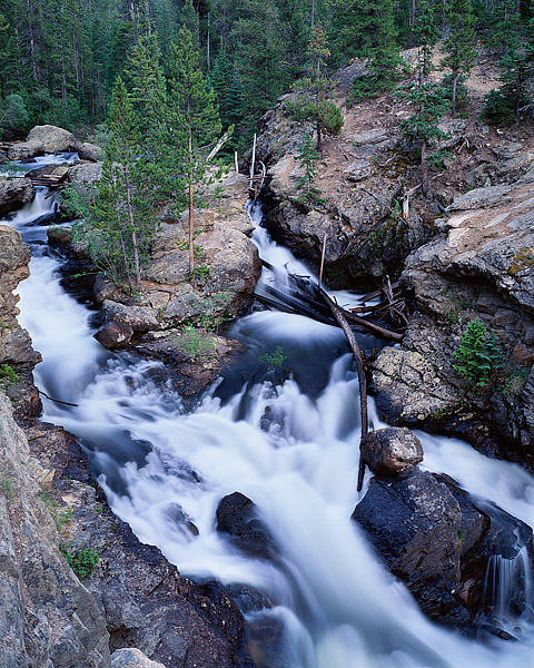 Adams Falls tumbles towards the Colorado River on the west side of Rocky Mountain National Park near Grand Lake. Adams Falls...