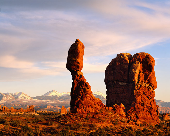 Sunset over Balanced Rock and the La Sal Mountains. This is a classic view of Balanced Rock in Arches National Park. Arches National...