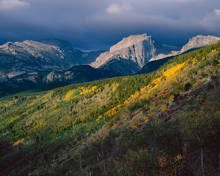 Ominous clouds greet the changing seasons. Hallet Peak and the Bierstadt Moraine are dapled in sun and shade on this beautiful...