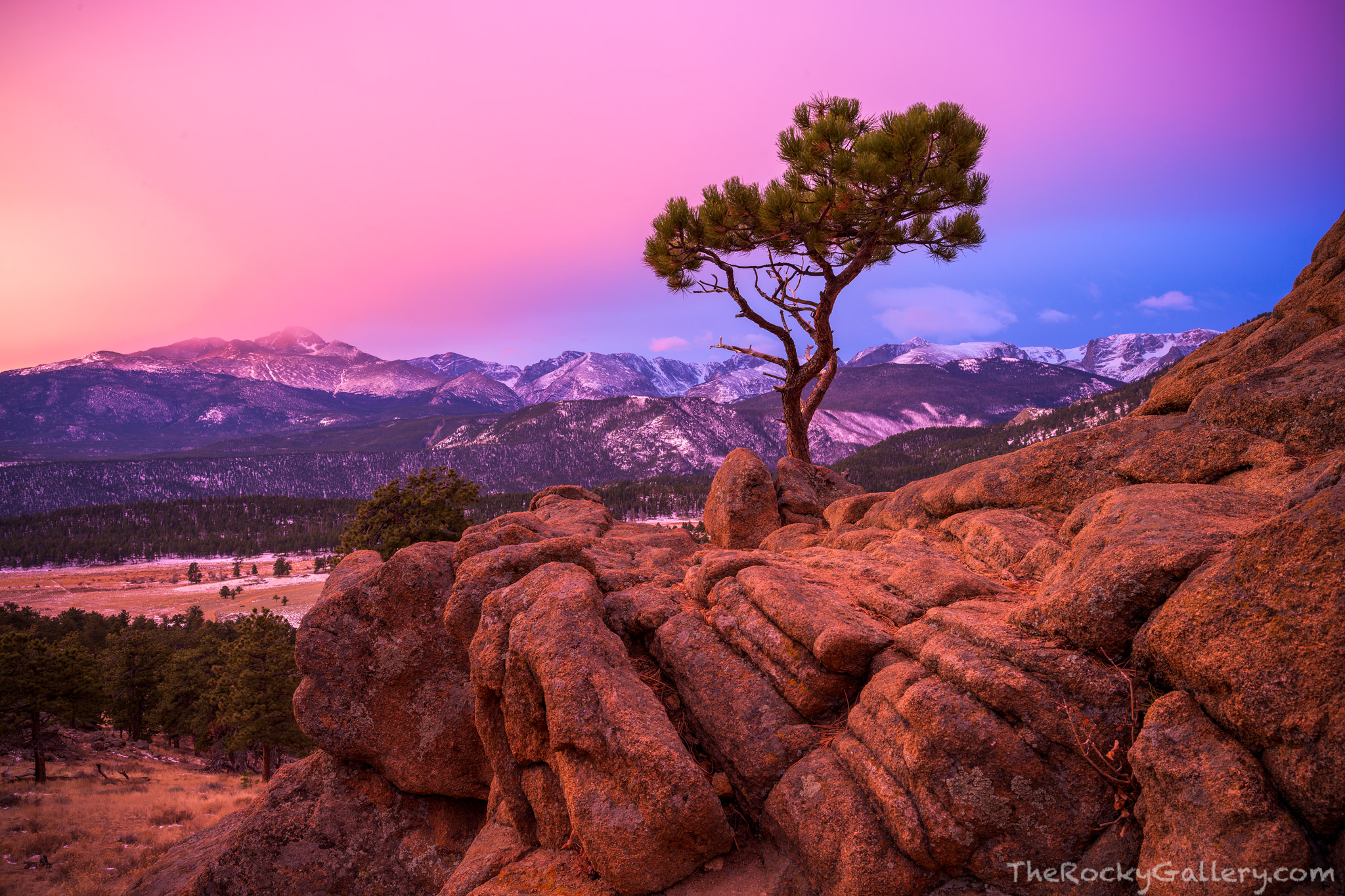 A colorful sunrise unfolds over the Continental Divide as viewed from above Upper Beaver Meadow.From left to right Longs...