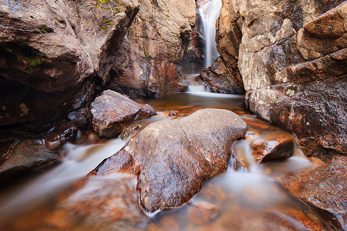 Fall River flows through the granite chamber that makes up Rocky Mountain National Parks Chasm Falls. Chasm Falls located near...