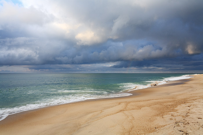 Storm clouds move out of the Hamptons and the South Shore of Long Island. Coopers Beach reveals a placid Hamptons Morning.