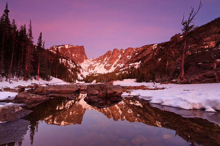 Dawn's pre-glow light bathes Hallet Peak, Flattop Mountain and Dream Lake in a soothing and surreal light. There is no wind on...