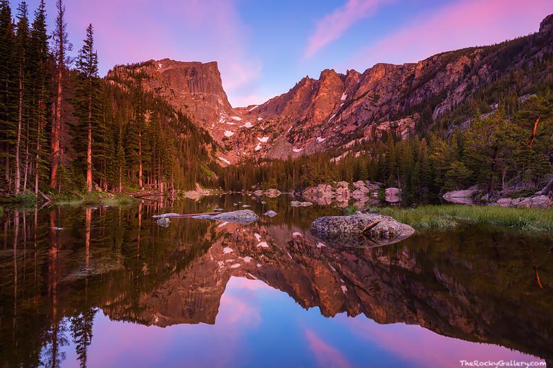 A spectacular pastel sky illuminates the sky over Hallett Peak, Flattop Mountain and Dream Lake as sunrise approaches. The still...