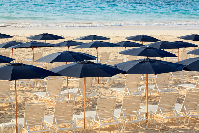 Morning on Elbow Beach. Umbrellas line the beach before most of the beach goers arrive.