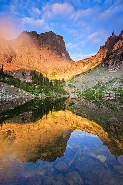 Fog hangs in the saddle below Hallet Peak as the sunrise briefly illuminates Emerald Lake. It had been raining in Rocky Mountain...