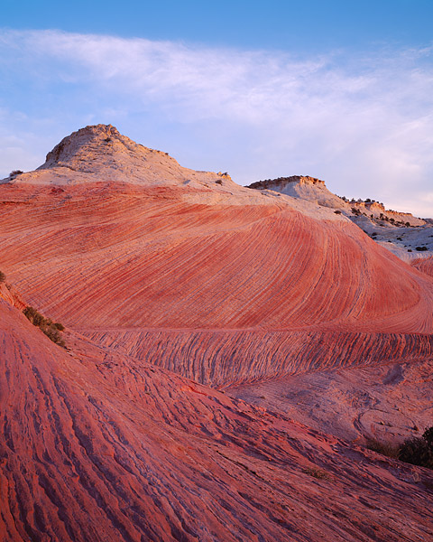 Sunrise in Escalante National Monument. These sandstone swirls are located near Hole in the Rock road just outside the town of...
