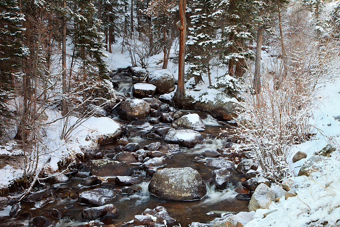Glacier Creek in Rocky Mountain National Park is thawed and flowing freely but Winter's grip still has a hold on Rocky Mountain...