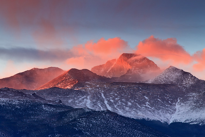 14,255 ft high Longs Peak takes on a spectacular red glow as the first rays of sun illuminate The Diamond. As beautiful a scene...