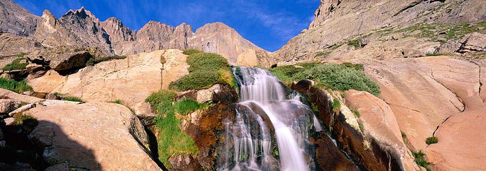 14,255 ft Longs Peak rises over Columbine Falls high above Rocky Mountain National Park. Columbine Falls flows below the 'Diamond...