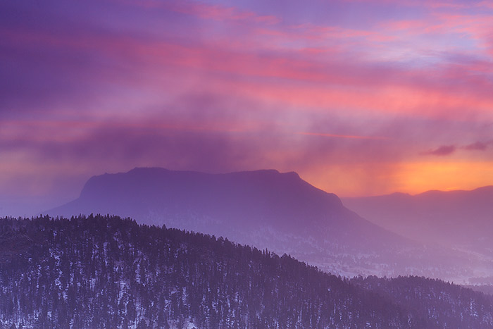 A colorful winter sunrise unfolds in the skies over Deer Mountain and RockyMountain National Park. Though the colors of...