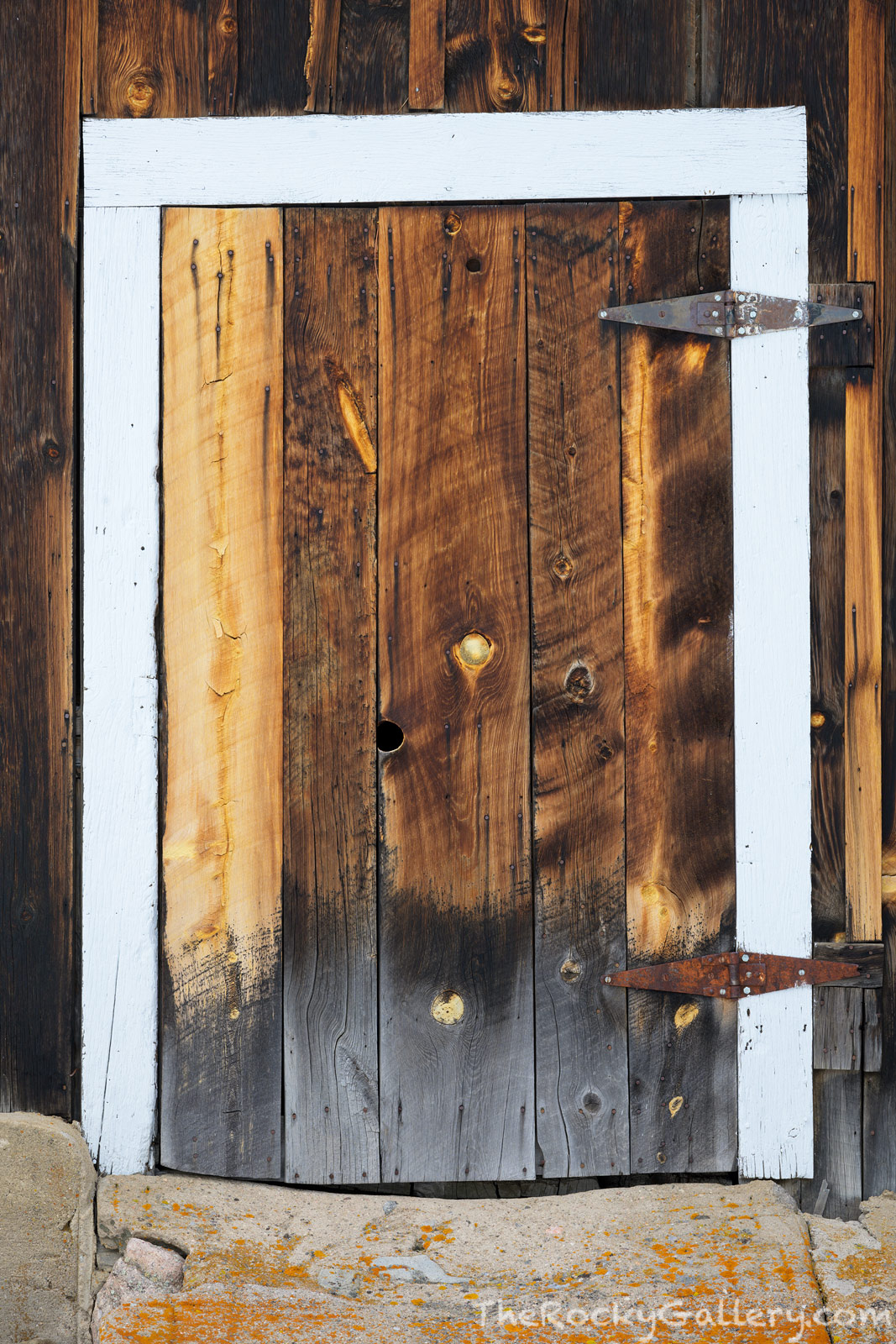 The west barn door at McGraw Ranch is a study in weathered wood and craftsmanship. This small barn door while crude also shows...