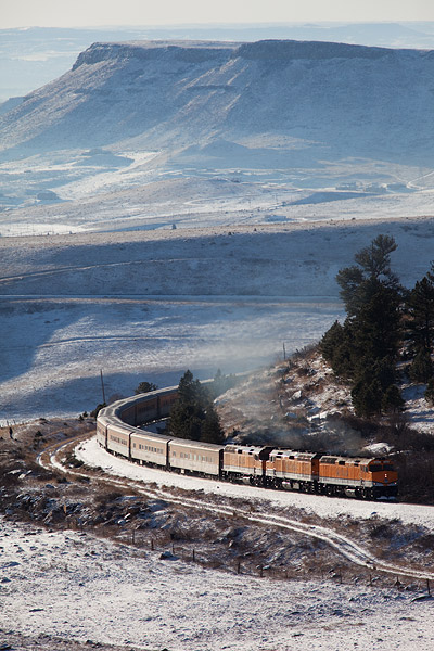 Denver's Ski Train rounds the curve at Clay, Colorado as it heads westbound towards the Ski Resort of Winter Park. Table Mountain...