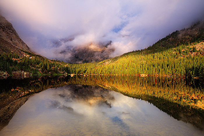 Heavy rains fell all through the night over Loch Vale in Rocky Mountain National Park. The weather calmed, the rain stopped and...