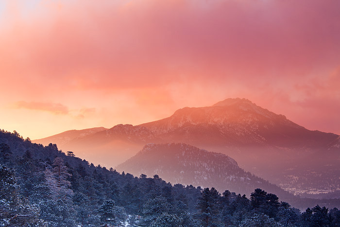 The brilliant morning sun peaks above the cloud line and illuminates the Estes Valley with a fire like appearance. While most...