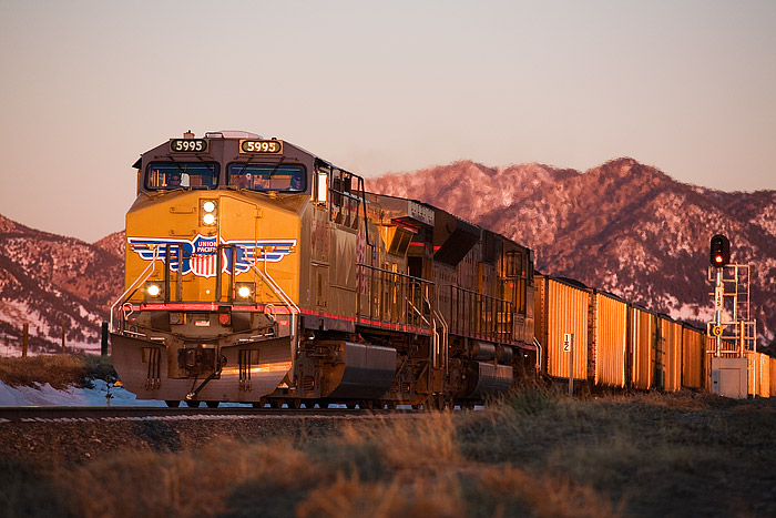 Union Pacific 5995 leads a loaded coal train east on the Moffat Subdivision west of Denver. The train is decending downgrade...
