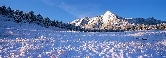 Snow and clear, crisp blue skies greet the famous Flatirons of Boulder, Colorado. This view of the Flatirons was photographed...
