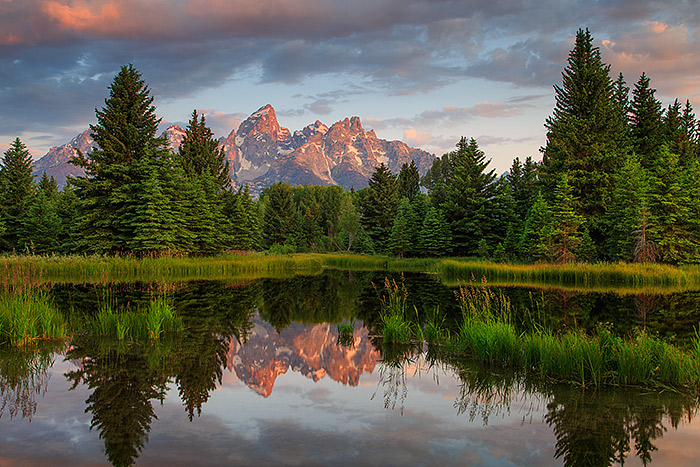 The Grand Teton and the Teton Range do their best to help celebrate a beautiful fourth of July at Grand Teton National Park....
